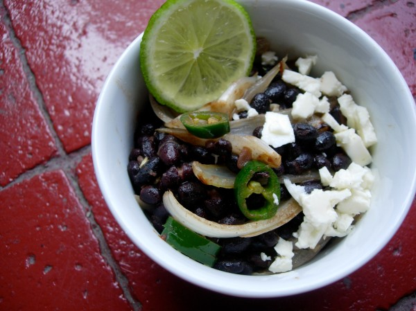 black beans with sautéed garlic and onions, chili, lime, a touch of cinnamon and brown sugar, good extra-virgin olive oil, and queso fresco